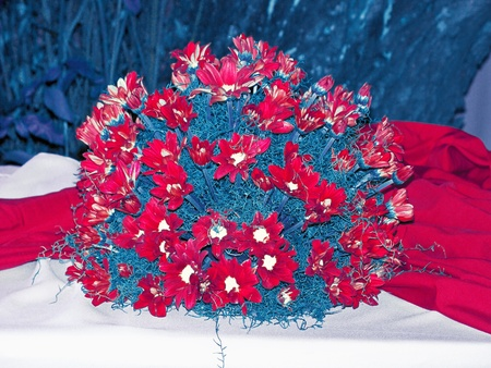 Rarity of daisies spherical bouquet on a table in red white and blue, USA patriotic colours