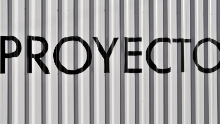 Proyect word on metallic striped background in black and white