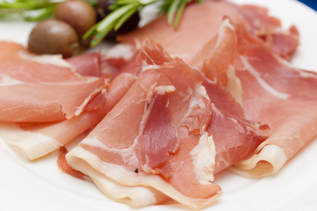 Jamon on white plateの写真素材