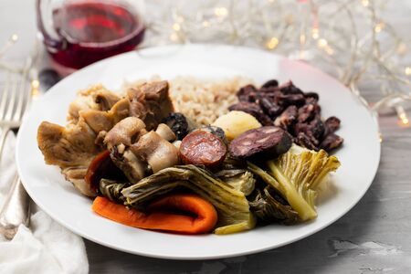 Photo for typical portuguese dish boiled meat, smoked sausages, vegetables and rice on white plate - Royalty Free Image