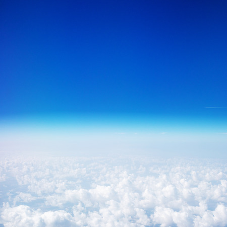Photo pour Beautiful Sky above the clouds. View from the airplane window with blue sky and fluffy clouds - image libre de droit