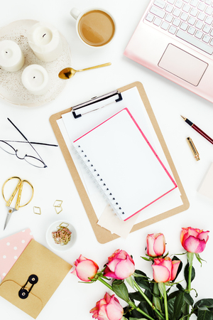 Photo for Flatlay frame arrangement with pink laptop, candles, roses, glasses and other accessories on white. Feminine business mockup, copyspace - Royalty Free Image