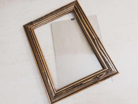 Photo for Frame of dark wood for needlework on a light background, horizontal photo - Royalty Free Image