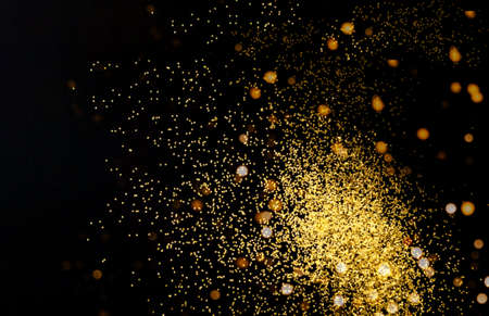 Photo pour Abstract dark background with golden sparkles. Blurred effect. Concept for festive background or for project. - image libre de droit