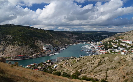 Marine Bay with Ukrainian ships against a background of mountains. Ukraine, Republic of Crimea