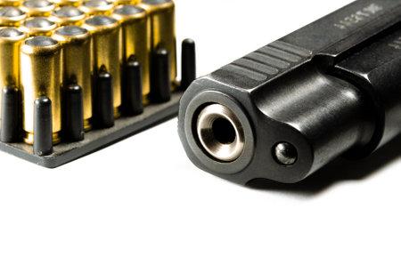 Foto de The legal traumatic short-barrel weapon lies on a white background next to the cartridges. Legalization of weapons - Imagen libre de derechos