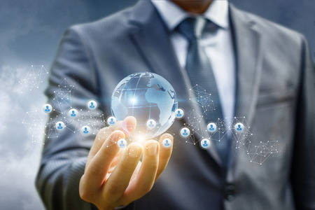 Photo pour Business man holds in hand a global business network. - image libre de droit