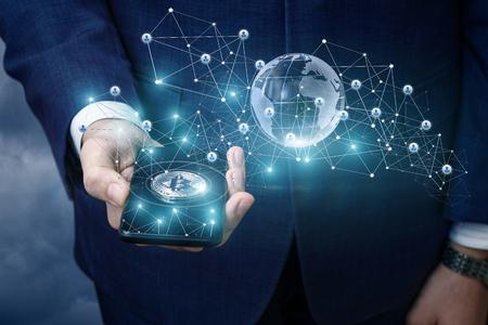 Foto de Bitcoin in a mobile phone from the network. - Imagen libre de derechos