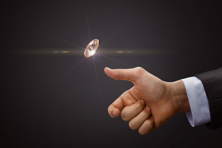 Foto de Hand throws a coin. The concept of decision-making. - Imagen libre de derechos