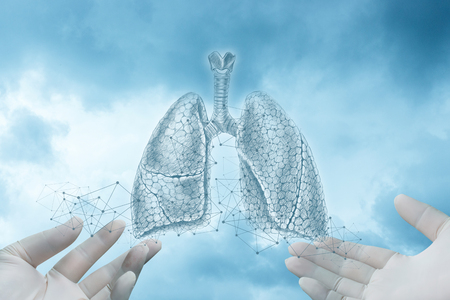 Photo pour Hands in gloves show a sketch of lungs on a blue background. - image libre de droit