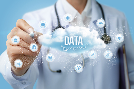 Photo pour Doctor draws the structure of the data cloud on a blue background. - image libre de droit