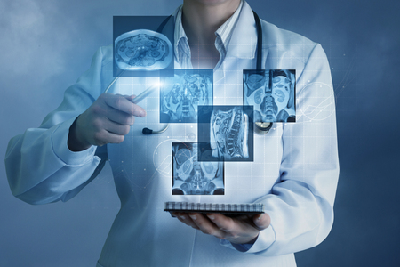 Doctor sees virtual images of the patient on a blue background.