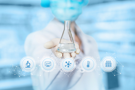 Photo pour A laboratory assistant is showing a flask with transparent substance inside at the laboratory equipment icons foreground. The concept is the laboratorian researchers. - image libre de droit