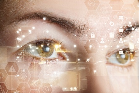 Photo pour A closeup of a human female eyes with comb cyber security system structure. The concept of data and digital protection and security. - image libre de droit