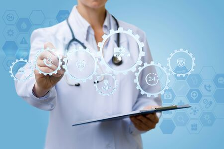 Photo for The doctor works with the mechanism of the health service on a blue background. - Royalty Free Image