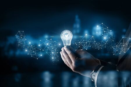 Photo for The concept of a quality idea. Hand shows a burning light bulb . - Royalty Free Image