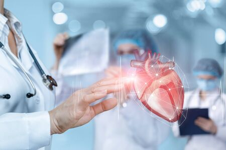 Photo pour Doctor clicks on a heart with a pulse on a blurred background. - image libre de droit