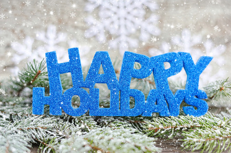 Photo pour Inscription of happy holidays with spruce branches with frost - image libre de droit