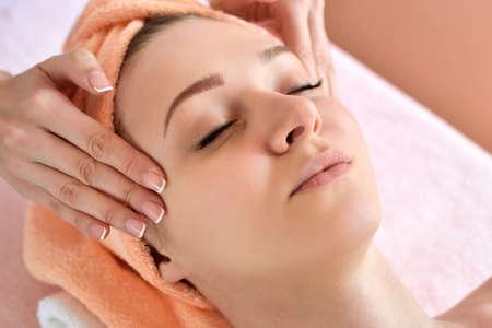 Photo pour Beautiful woman receiving massage from female therapist in spa. Beauty wellness concept - image libre de droit