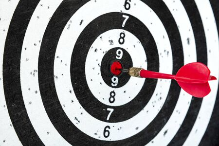 Photo pour Aim with arrow in the center. Target on a blue background with a red dart. - image libre de droit