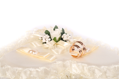 Two golden wedding rings on silk. Wedding background