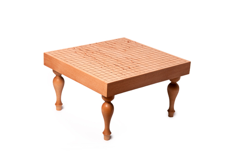 Table for traditional chinese strategy board game Go on white background