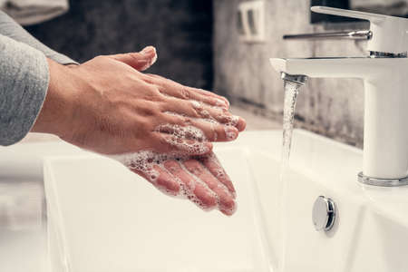 Photo pour Coronavirus. Proper washing and handling of hands. Liquid antibacterial soap. Self-isolation and hygiene - image libre de droit
