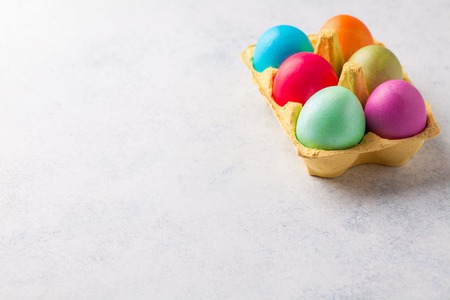 Painted eggs in a stand on a gray background, easter