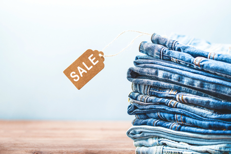 Concept sales, blue jeans on a light background Copyspace.