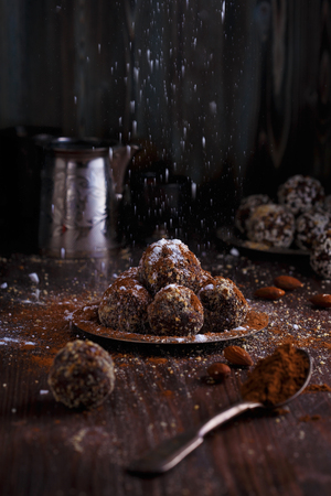 Photo pour Healthy energy organic vegetarian bites with nuts, dates, honey, cacao and sesame on a dark wooden background. - image libre de droit