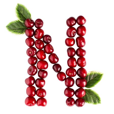One English letter N Alphabet of ripe cherries. Isolate on white background. Summer, healthy concept. Juicy berries.