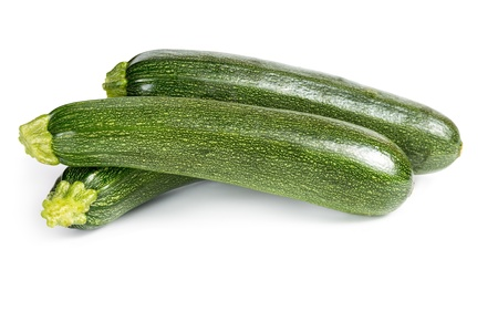 Three ripe zucchini isolated on a white background