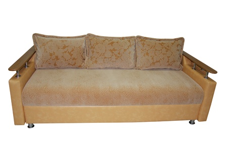 brown comfortable sofa with pillows isolated on white