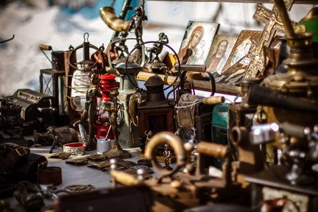 Old fashioned  antique decorative items on the Kiev's flea market, winter.