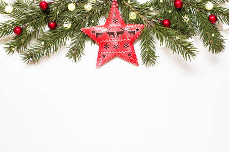 Photo pour Composition with christmas tree branches, star and christmas lights on white background. - image libre de droit