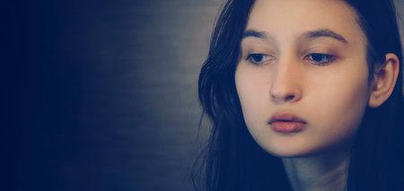 Photo pour Panoramic banner with a portrait of a beautiful girl, place for text, copy-space. - image libre de droit