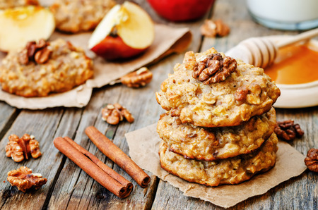 apples oats cinnamon cookies on a dark wood background. the toning. selective focus