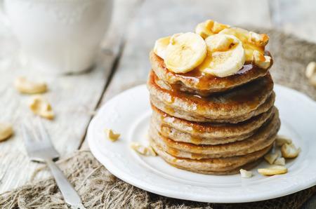 banana cashew pancakes with bananas and salted caramel sauce. the toning. selective focus
