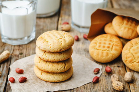 peanut butter cookies on a dark wood background. the toning. selective focus