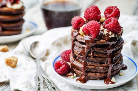 chocolate pancake with bananas, raspberries, nuts and chocolate sauce