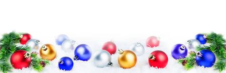 Photo pour Christmas colored balls on snow isolated - image libre de droit