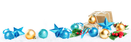 Photo pour Christmas lantern with gifts, colored balls and stars on snow isolated background. Christmas background concept - image libre de droit