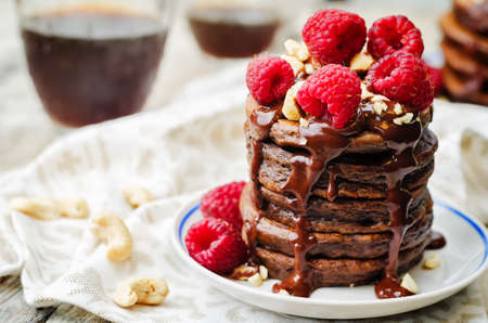 Photo for chocolate pancake with bananas, nuts, chocolate sauce and glass of coffee. the toning. selective focus - Royalty Free Image