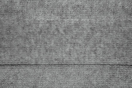 b232831d6e603 Wool sweater texture close up. Knitted jersey background with a relief  pattern. Braids in