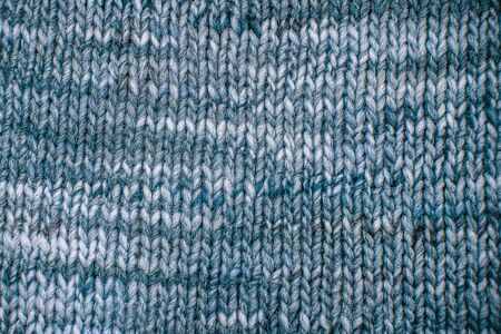 dfd8717f1d82c Blue Wool scarf texture close up. Knitted jersey background with a relief  pattern. Braids