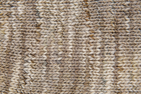1d8d6d8ce8817 Wool scarf texture close up. Knitted jersey background with a relief pattern.  Braids in
