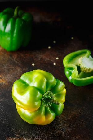 Foto für Sweet green pepper on dark background. Fresh yellow green bell pepper (capsicum) - Lizenzfreies Bild