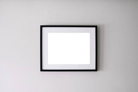 Photo pour Blank frame on a white wall background - image libre de droit