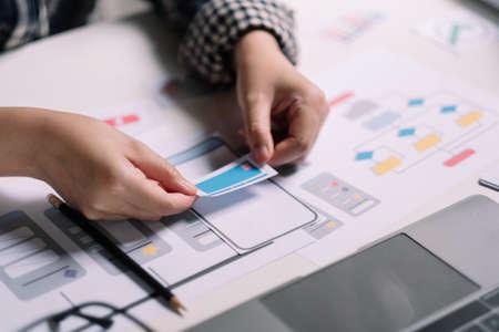 Photo pour ux designer creative Graphic planning application development for web mobile phone or computer. User experience concept - image libre de droit