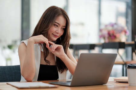 Photo pour Portrait of attractive asian business woman working with laptop computer for group online meeting conference, - image libre de droit